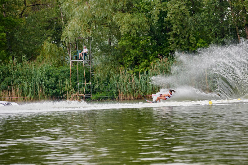 Woman riding wakeboard stock photography