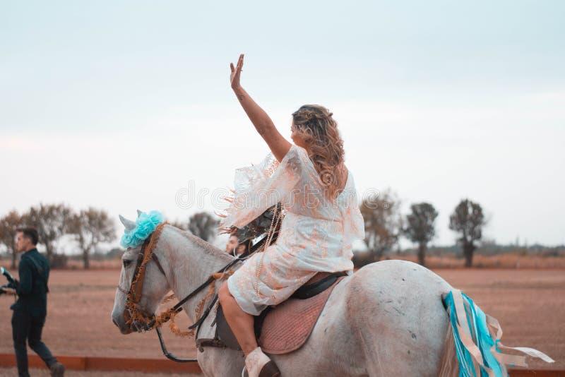 Woman Riding on White Horse stock image