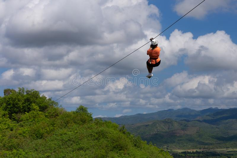 Woman riding in zip line in the Valley of Sugar Mills in Trinidad Cuba. Woman riding in zip line in the Valley of the Sugar Mills in Trinidad Cuba royalty free stock photography