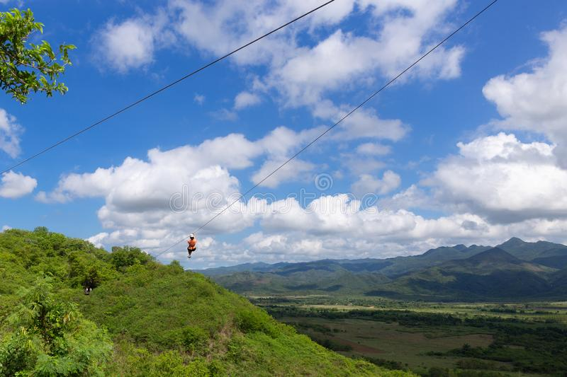 Woman riding in zip line in the Valley of the Sugar Mills in Trinidad in Cuba royalty free stock photos