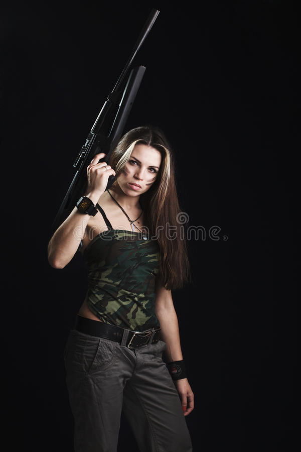 Woman with rifle royalty free stock photo