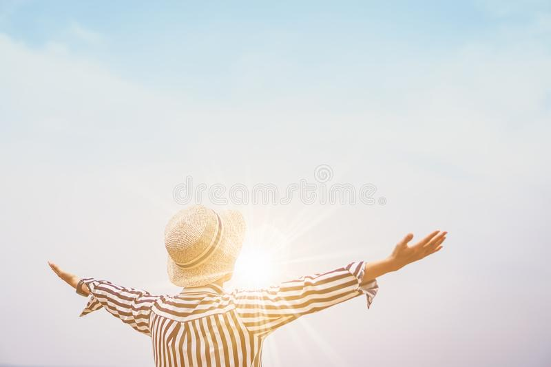 Woman rise hands up to sky. stock images