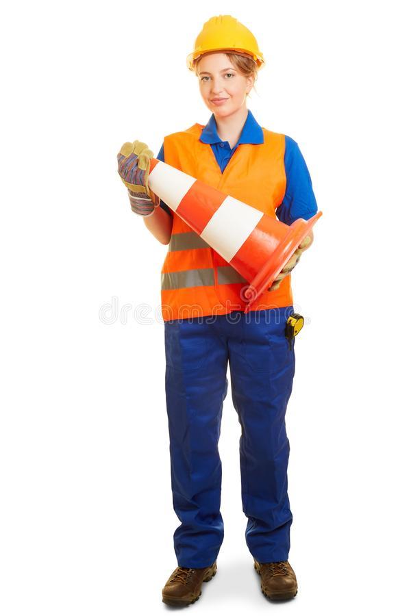 Woman in road construction in workwear with pyon royalty free stock images