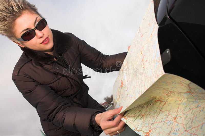 Woman with road map stock photography