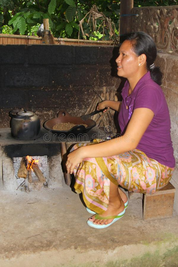 Woman is roasting exclusive coffee beans of the civet cats, Bali. Woman is roasting exclusive and expensive coffee beans of the civet cats at Bali, Indonesia stock images