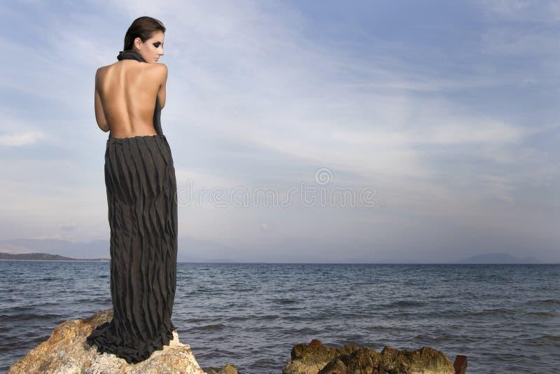 Download Woman on a rock stock image. Image of slim, seashore - 15161999