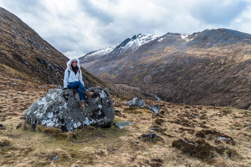 Woman on a rock stock photo