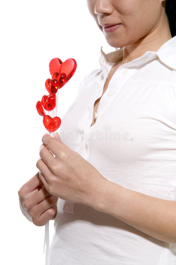 Woman with romantic lollipops stock image