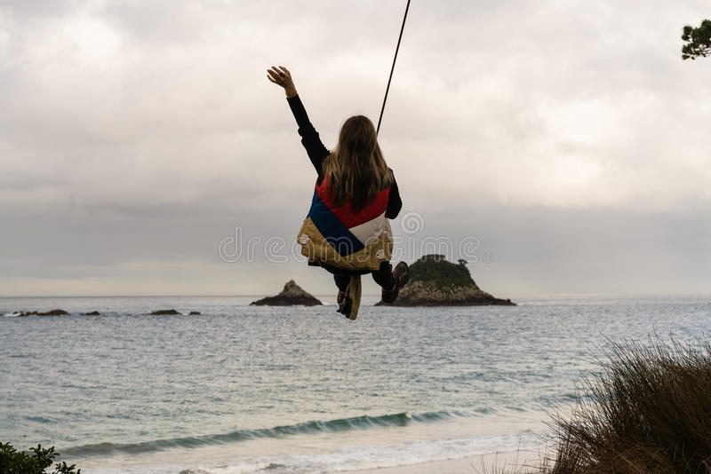 Woman On Rope Swing stock photos