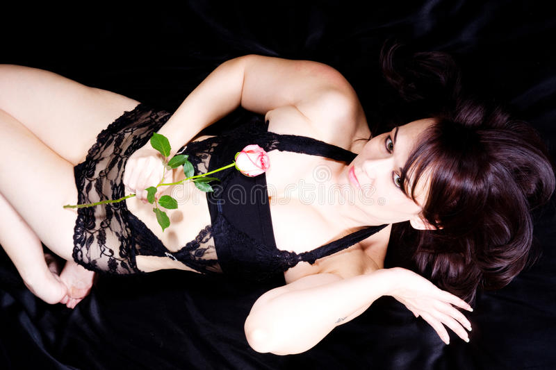 Download Woman and rose stock photo. Image of pretty, young, flower - 23185910
