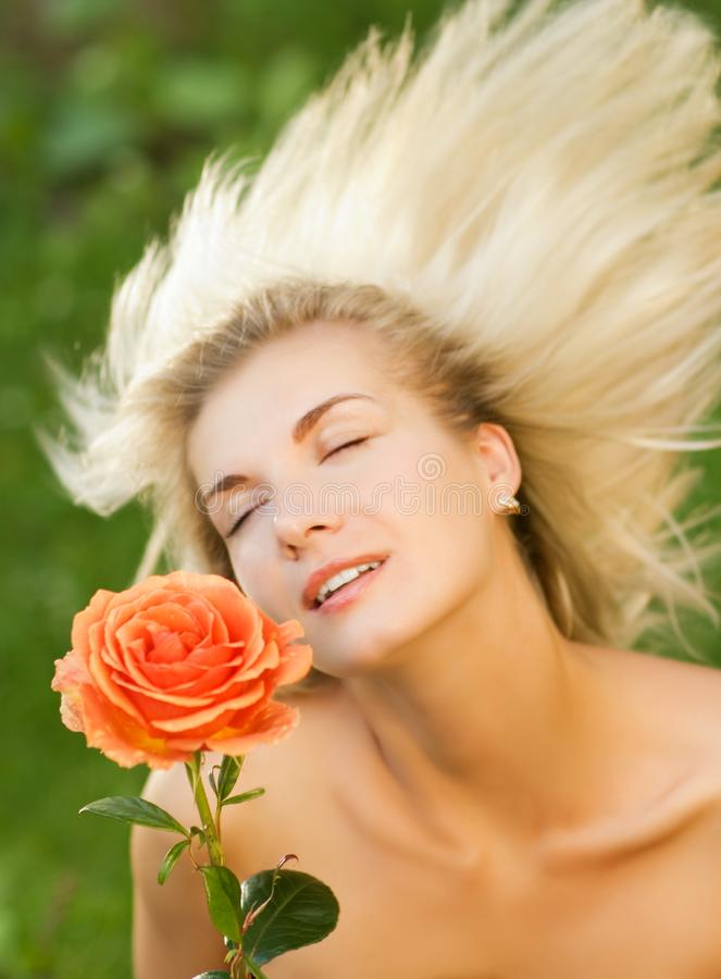 Woman with a rose royalty free stock photo