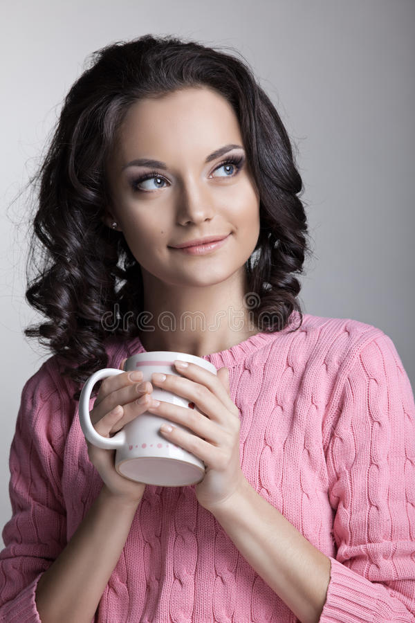 Woman In Rose Jacket With Cup Of Tea Royalty Free Stock Photography