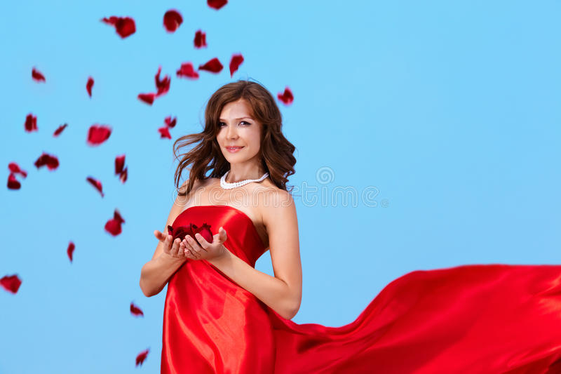 Download Woman with rose petals stock image. Image of fashionable - 28376409