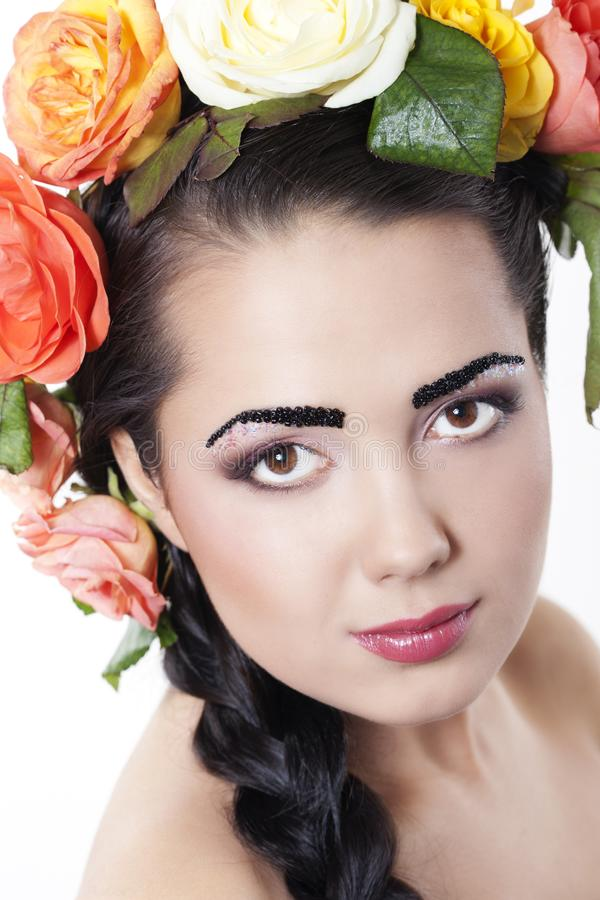 Woman with roses in hair stock photography