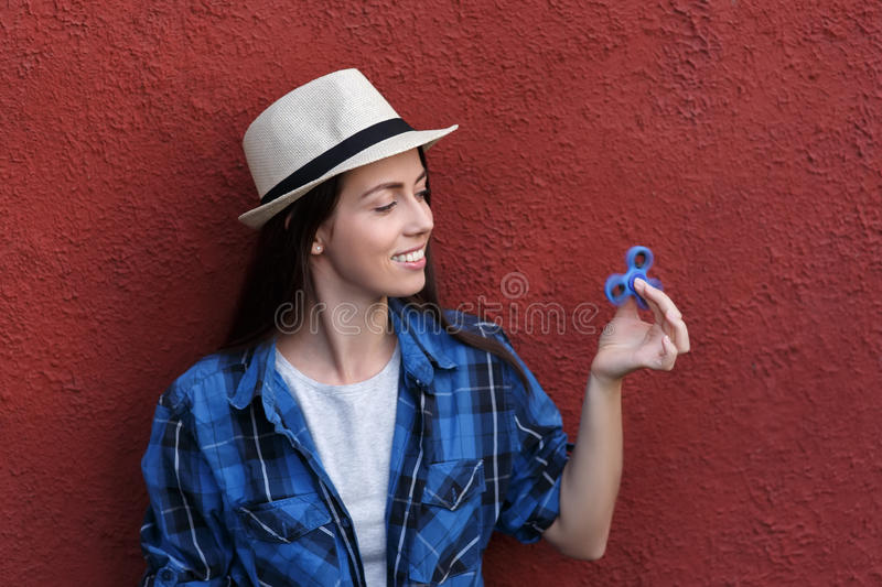 Woman with rotating fidget spinner stock images