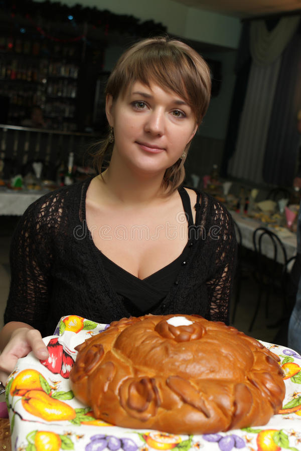 Woman with round loaf stock photography