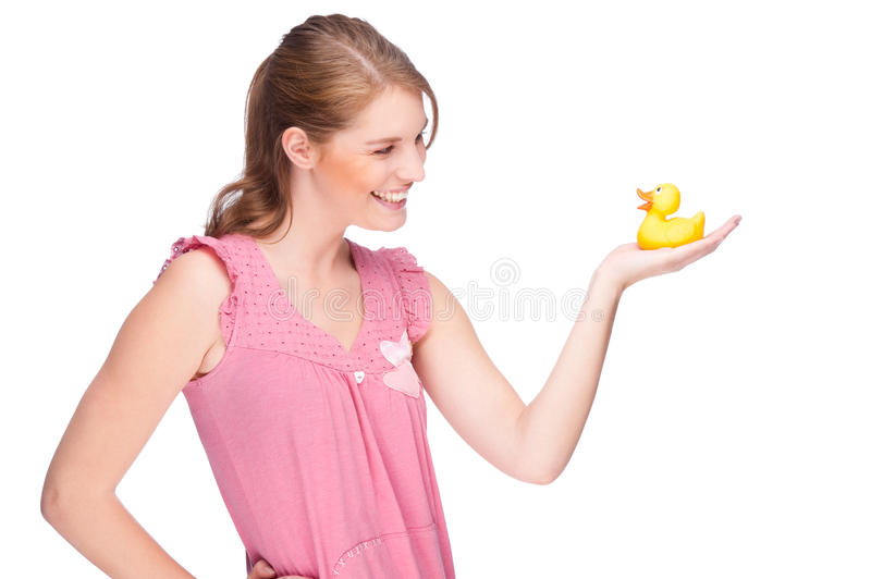 Woman with rubber duck stock image