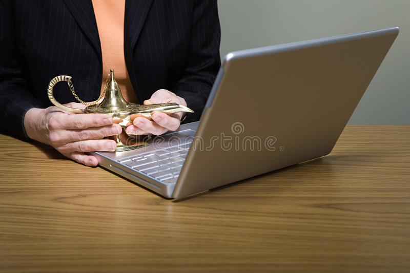 Woman rubbing genie lamp royalty free stock images