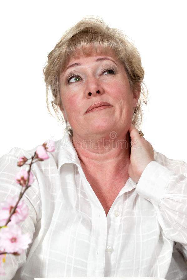 Woman rubbing stiff neck stock photo