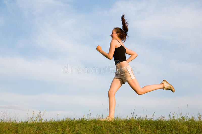 Woman run in field stock images