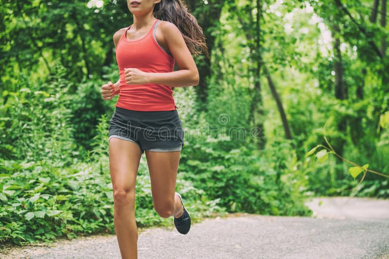 Woman runner on city run marathon race running jogging outdoors in summer active sport lifestyle. Healthy living royalty free stock photo