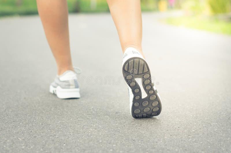 Female runner feet jogging on street. stock photos