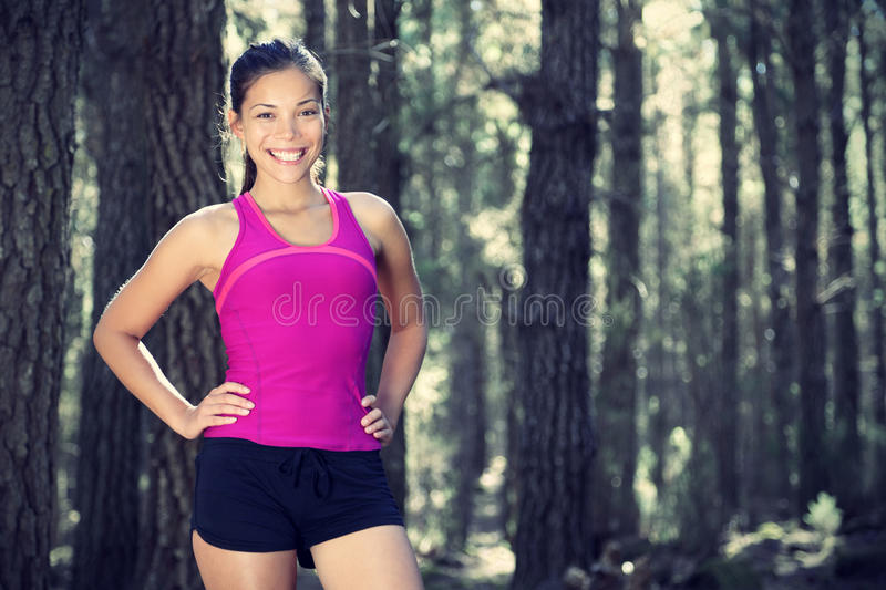 Woman runner in forest royalty free stock photography