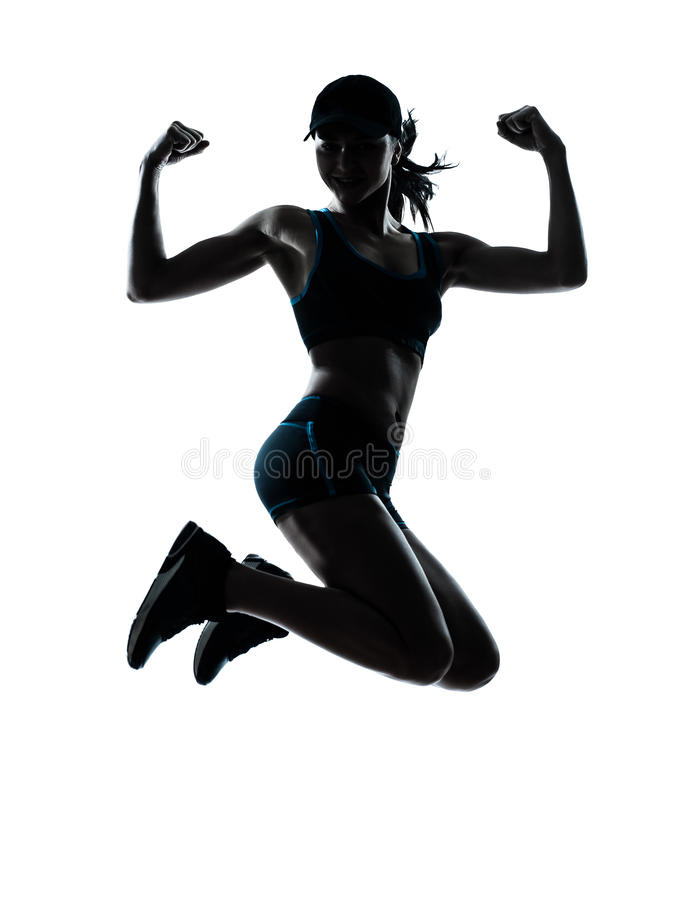 Woman runner jogger jumping powerful. One caucasian woman runner jogger jumping powerful in silhouette studio isolated on white background stock photography