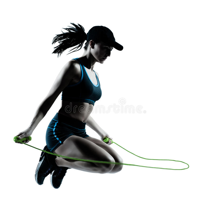 Woman runner jogger jumping rope royalty free stock photography