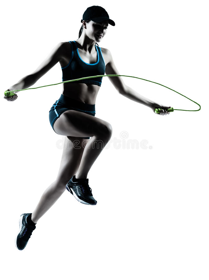 Woman runner jogger jumping rope. One caucasian woman runner jogger jumping rope in silhouette studio isolated on white background royalty free stock images