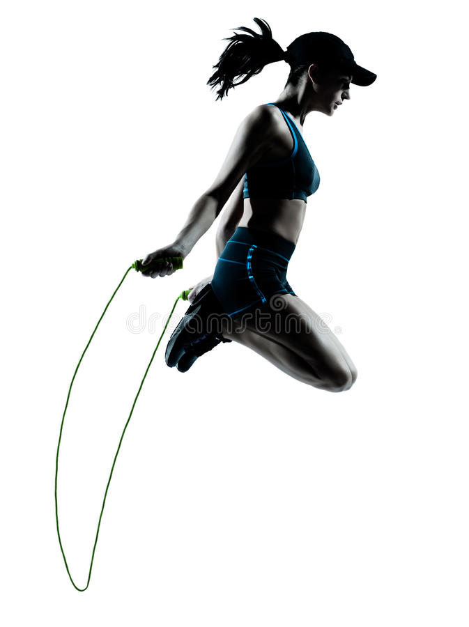 Woman runner jogger jumping rope. One caucasian woman runner jogger jumping rope in silhouette studio isolated on white background stock photos