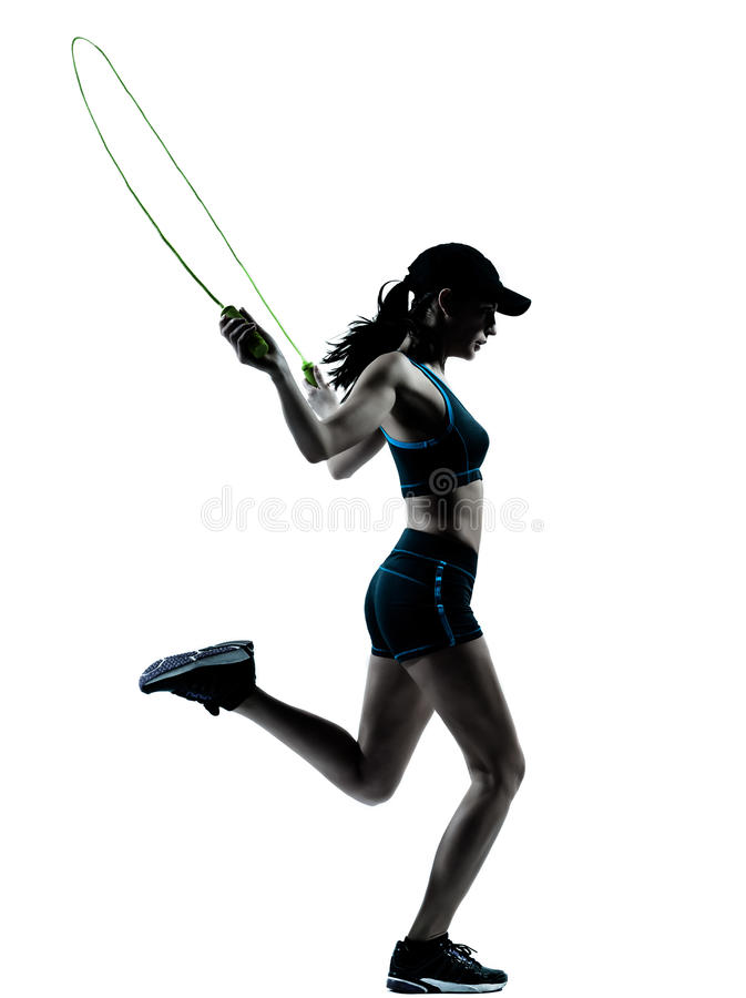 Woman runner jogger jumping rope. One caucasian woman runner jogger jumping rope in silhouette studio isolated on white background stock photography