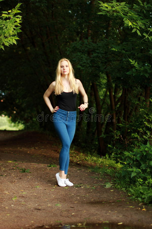 Woman runner running jogging in summer park. royalty free stock photo