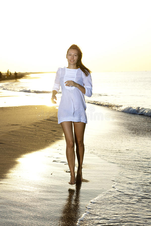 Download Woman running on the beach stock image. Image of happy - 24034825