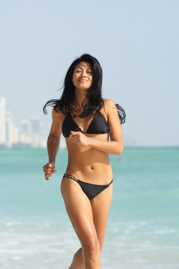 Download Woman Running On The Beach Stock Image - Image: 4565131