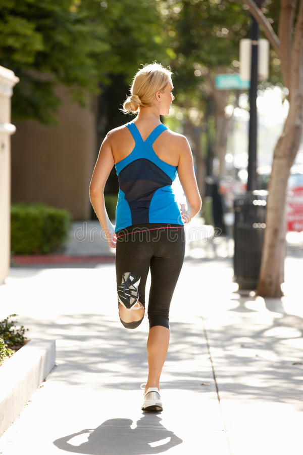 Download Woman Running On City Street Royalty Free Stock Images - Image: 20893379