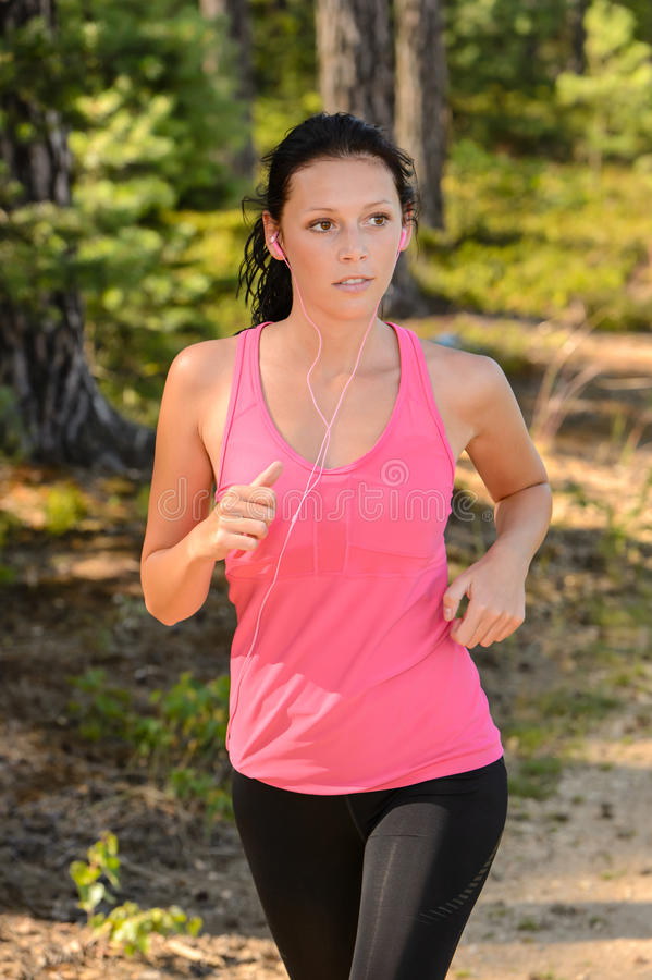 Woman running in the countryside stock image