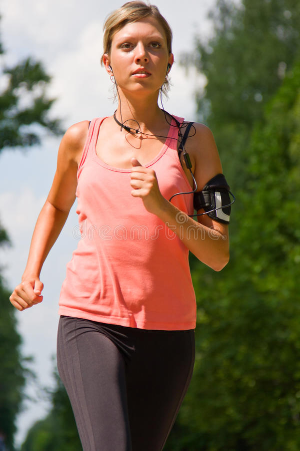 Free Woman Running In The Park. Royalty Free Stock Photos - 15333008