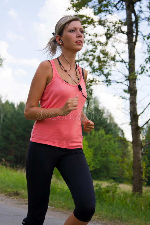 Free Woman Running In The Park. Stock Image - 15333021
