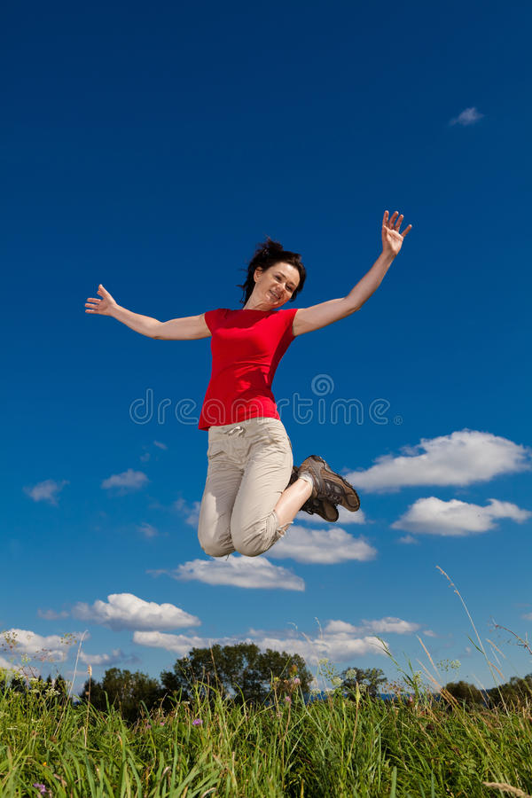 Woman running, jumping royalty free stock photo