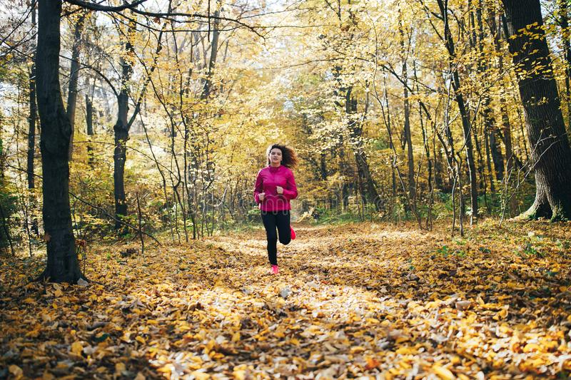 Woman running during morning park stock photos