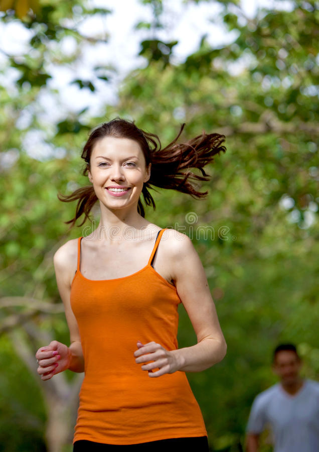 Download Woman running outdoors stock photo. Image of lifestyle - 12087352