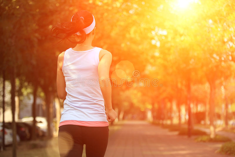 Woman running at park royalty free stock photography