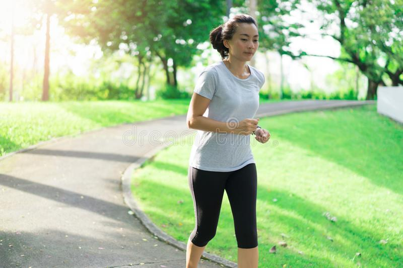 Woman running at public park. Workout concept stock photos