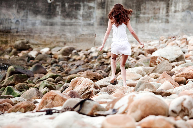 Woman running on the rocks royalty free stock images