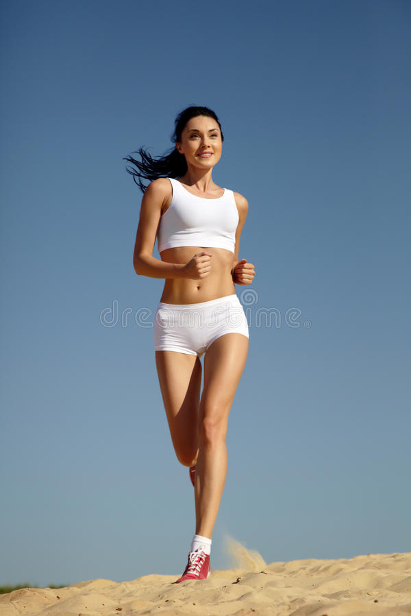 Download Woman running on sand stock image. Image of outdoor, running - 15045021