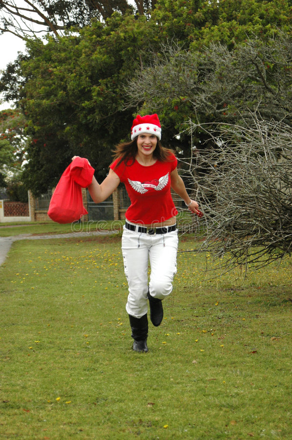 Download Woman running in Santa hat stock image. Image of gifts - 3374745