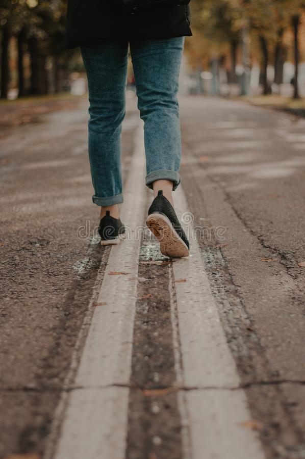 Woman running in the street. Feet royalty free stock photo
