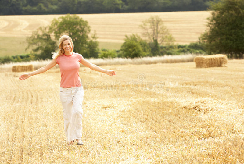 Woman Running Through Summer Harvested Field royalty free stock photos