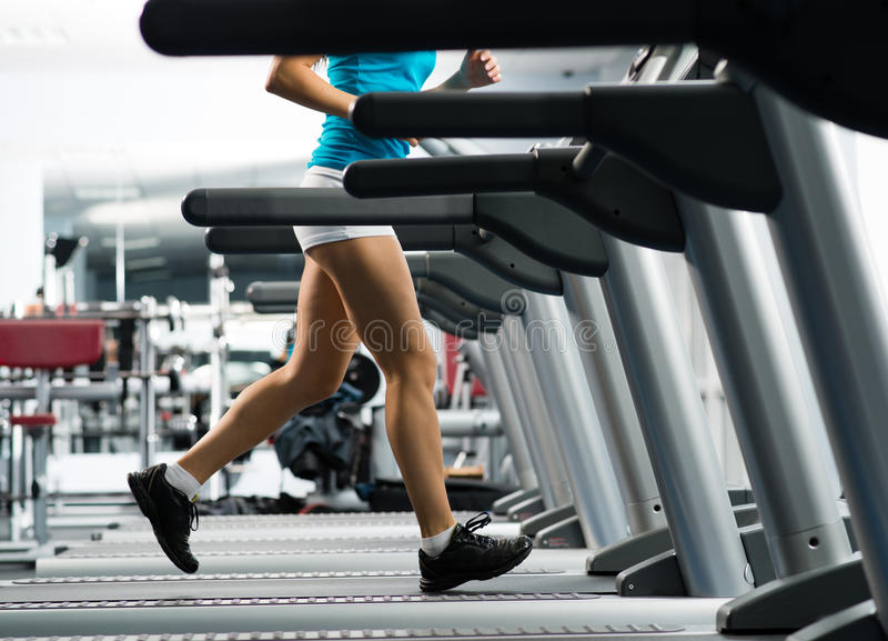 Download Woman Running On A Treadmill Stock Photo - Image: 28348738